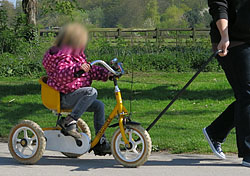 Towing one of the trikes using a pull-rod
